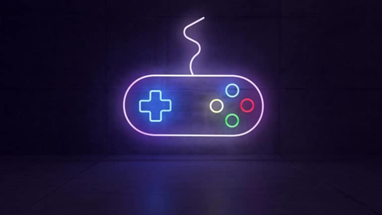 game joystick neon light with colorful light effect in dark concrete room 3d rendering